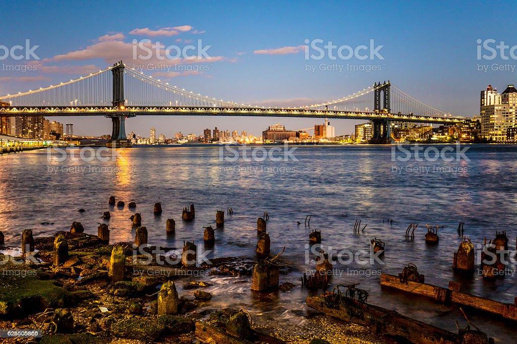 Manhattan bridge over East river in evening stock photo