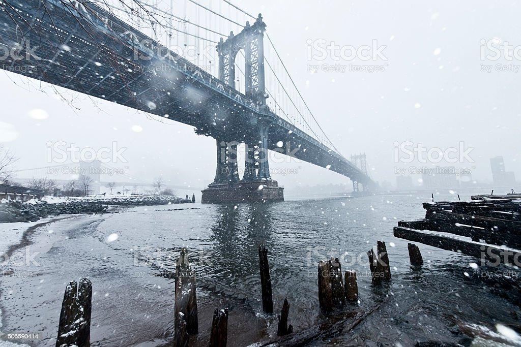Manhattan Bridge Under Snowstorm stock photo