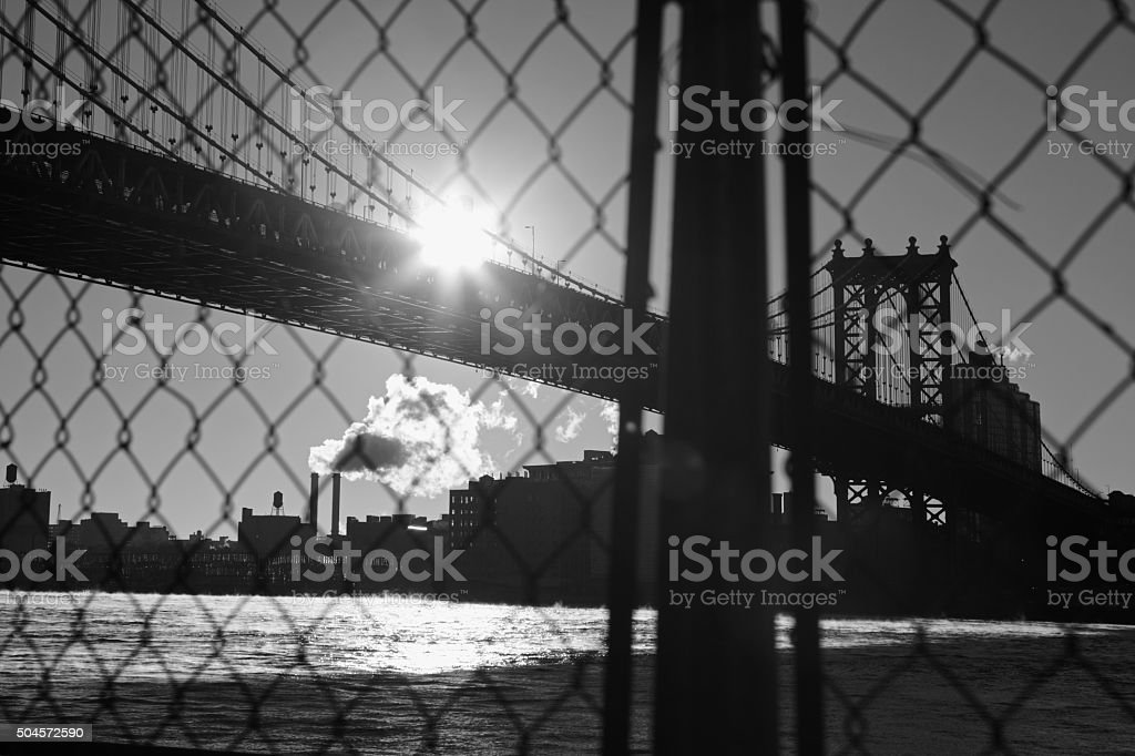 Manhattan Bridge waterfront New York City through a wire fence stock photo