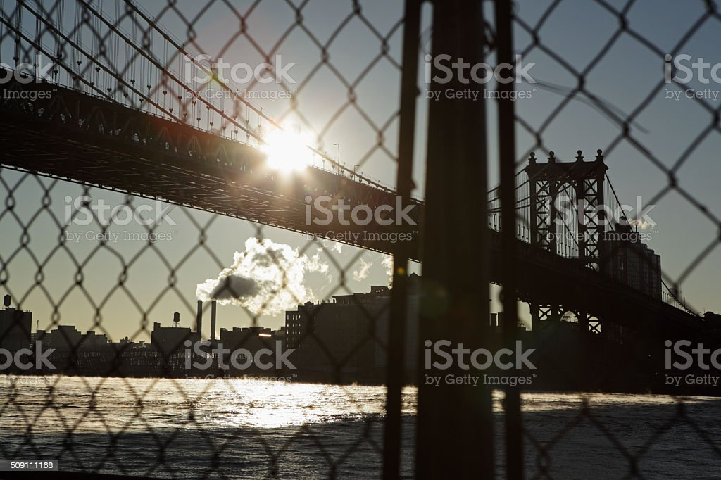 Manhattan Bridge waterfront New York City through a wire fence stock photo