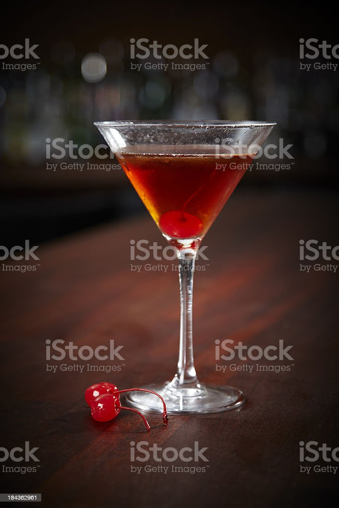 A Manhattan cocktail with cocktail cherries stock photo