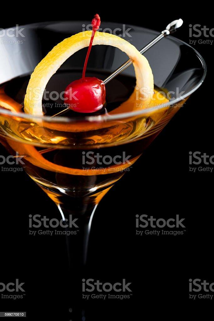 Manhattan cocktails on black background with garnish stock photo