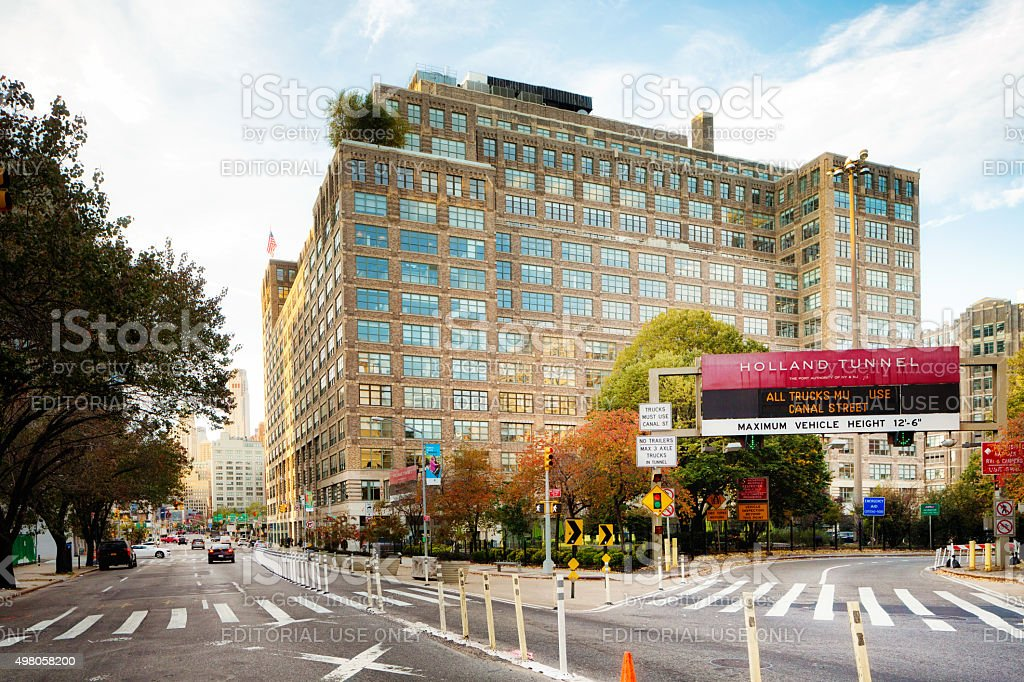 Manhattan Holland Tunnel entryway with office building stock photo
