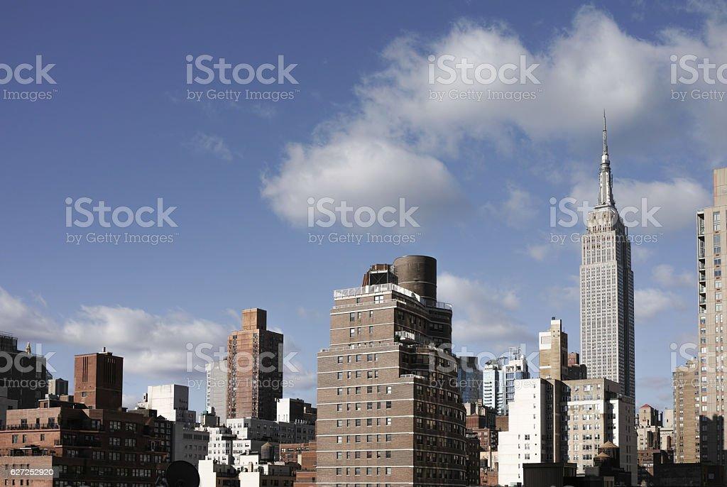 Manhattan midtown cityscape on a sunny day, harsh midday light, stock photo