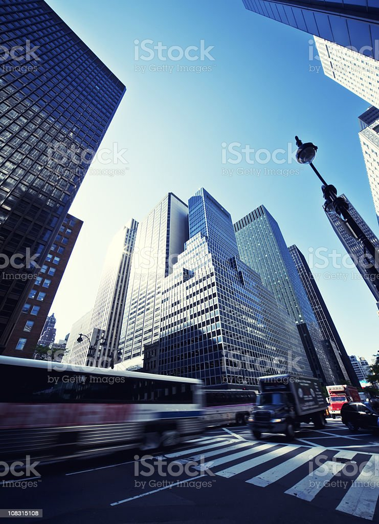 manhattan morning street traffic with skyscrapers in sun royalty-free stock photo