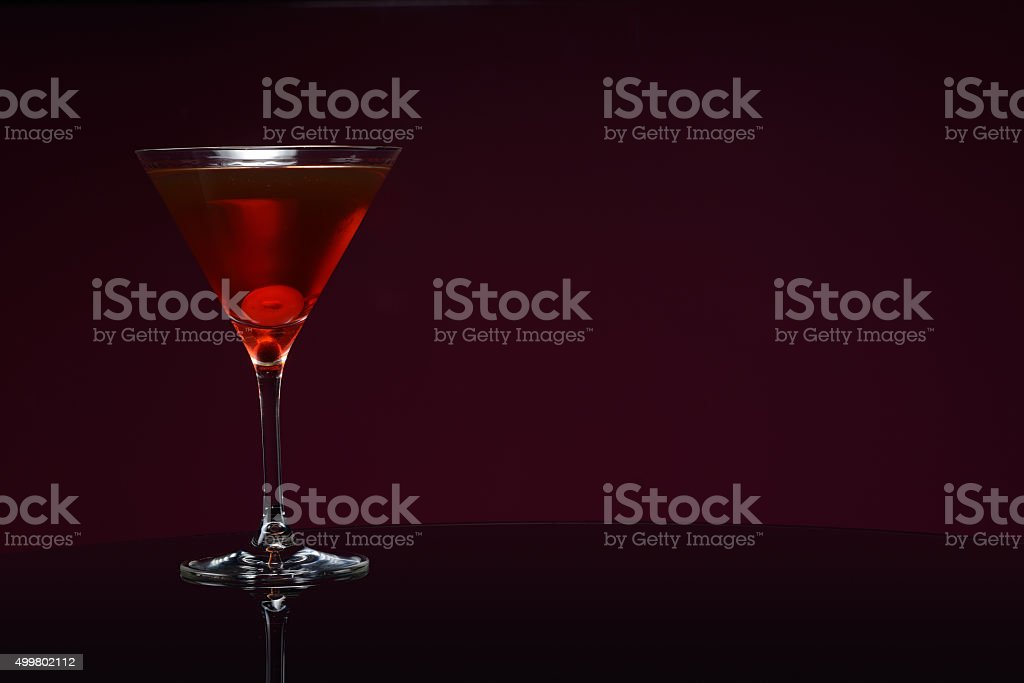 manhattan on the table with cherry stock photo