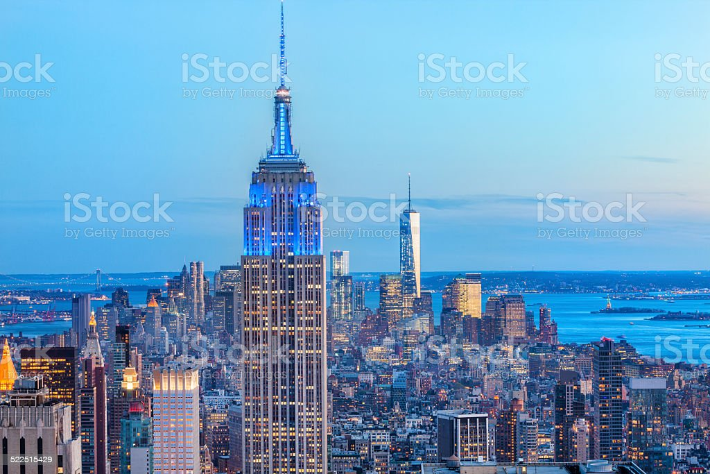 Manhattan panorama with its skyscrapers illuminated at dusk, New York stock photo