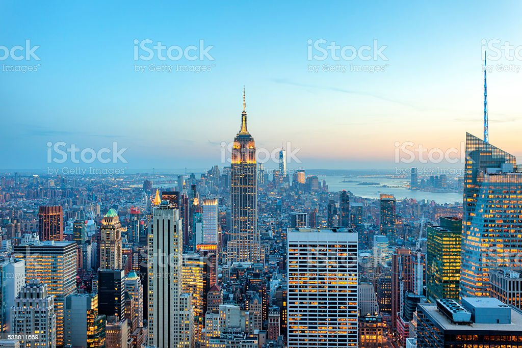 Manhattan panorama with its skyscrapers illuminated at dusk, New York stock photo