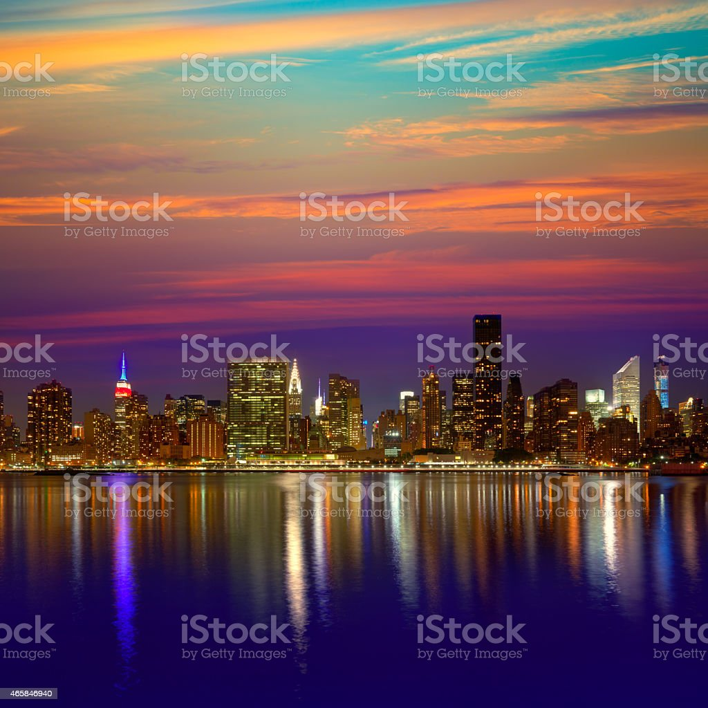 Manhattan skyline at dusk looking over river stock photo