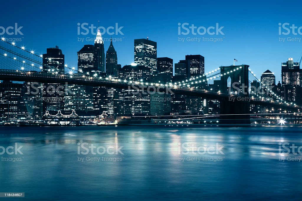 manhattan skyline at dusk with brooklyn bridge in front royalty-free stock photo