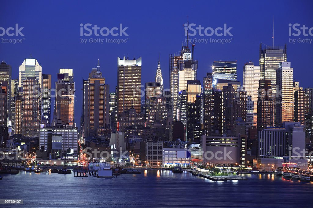 Manhattan skyline from the sea at night royalty-free stock photo