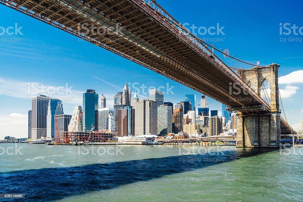 Manhattan Skyline From Under The Brooklyn Bridge stock photo