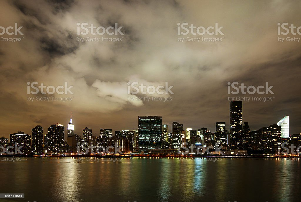 Manhattan skyline view from Brooklyn at night time royalty-free stock photo