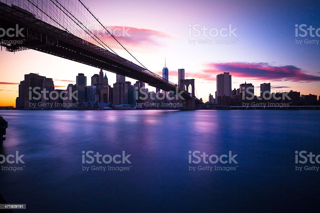 Manhattan Skyline with Brooklyn Bridge at Sunset stock photo