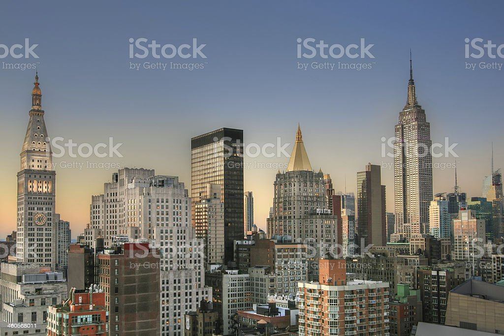 Manhattan Skyline with Empire State building at sunset, New York. stock photo