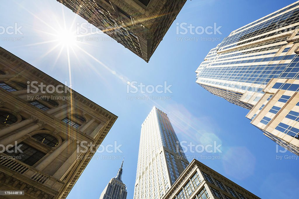 Manhattan skyscraper against Sun royalty-free stock photo