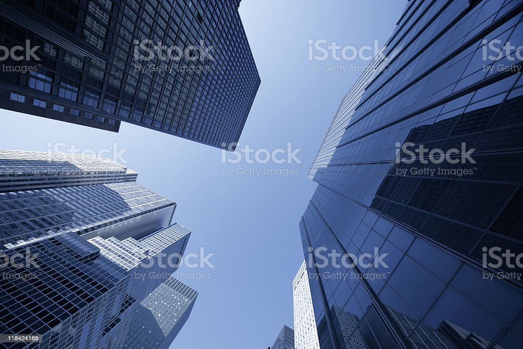 manhattan skyscraper reflecting in facade royalty-free stock photo