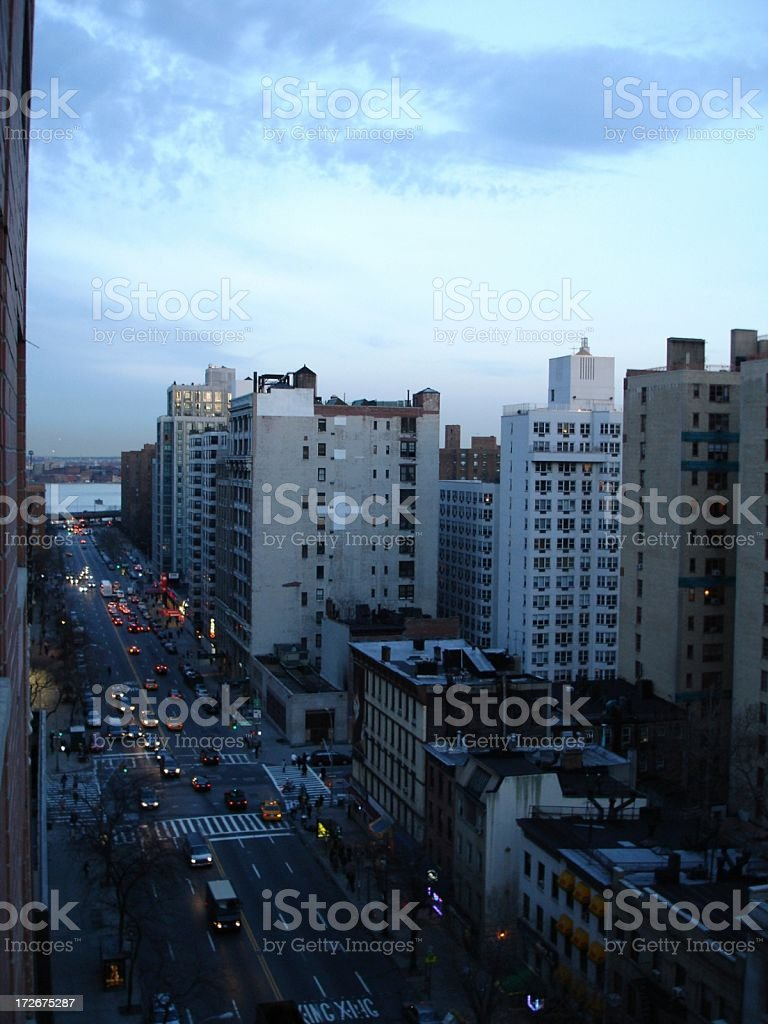 NYC - Manhattan Street at Night with East River royalty-free stock photo