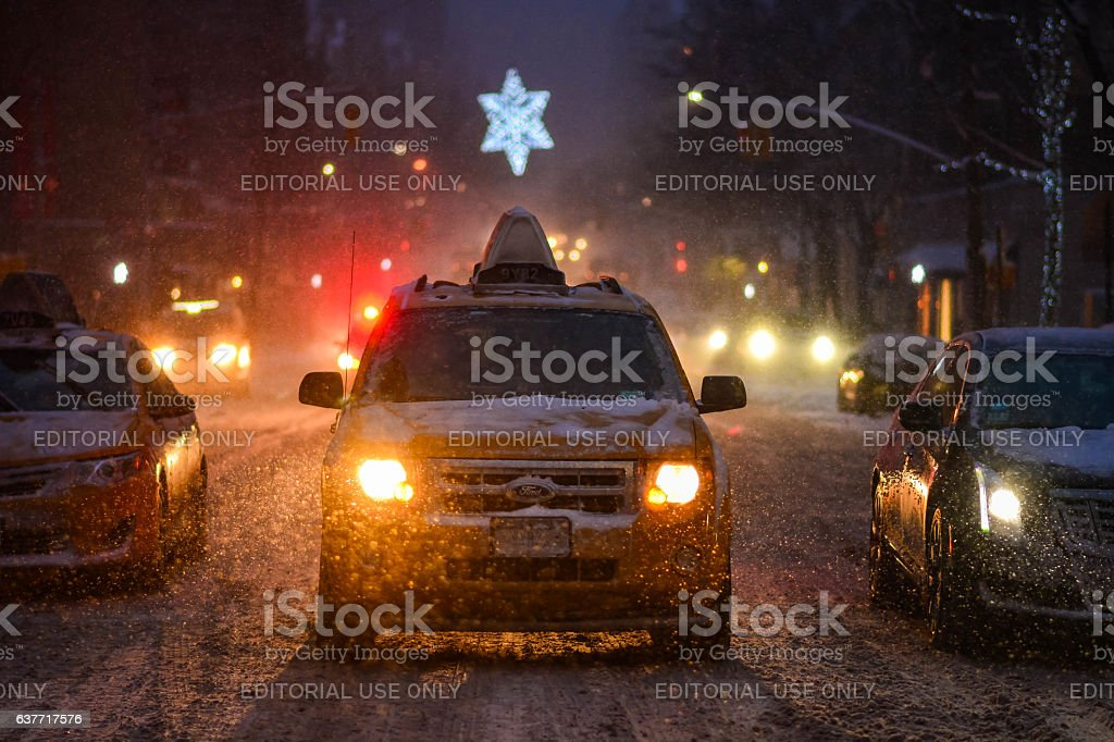 Manhattan street taxi and cars during the snow storm stock photo