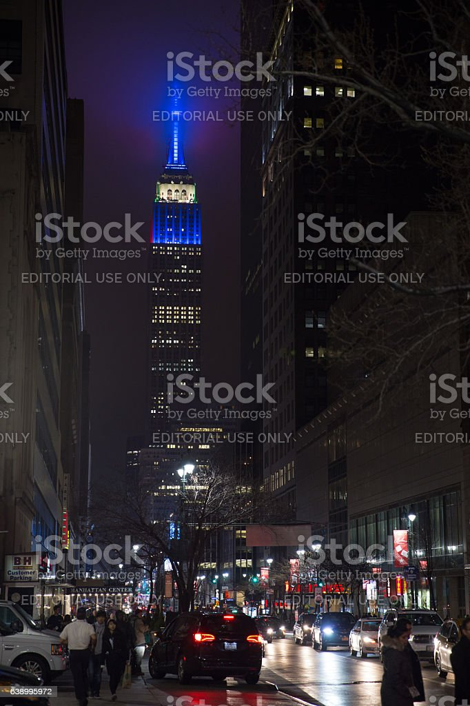 Manhattan streets at night and lighted Empire State Building stock photo