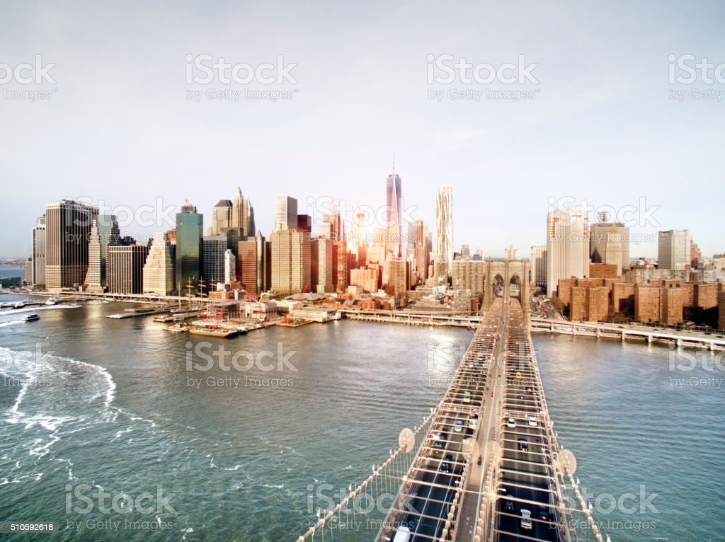Manhattan sunset from Brooklyn bridge park stock photo