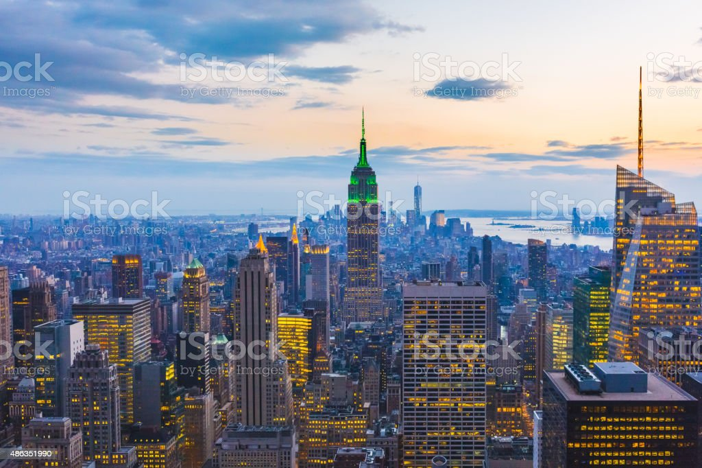 Manhattan view and skyscrapers illuminated during twilight stock photo