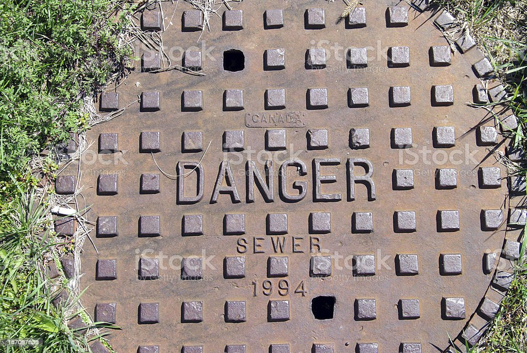 Manhole cover for the sewer system royalty-free stock photo
