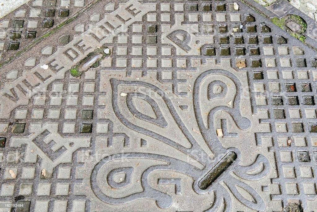 Manhole cover in Lille, France stock photo
