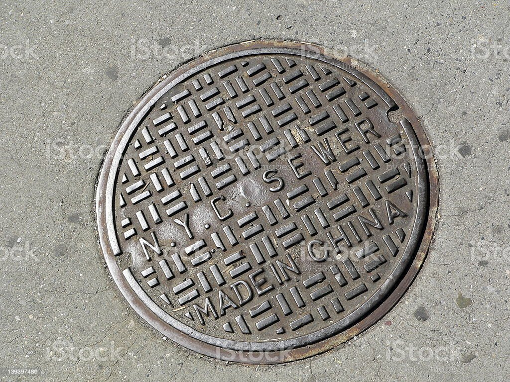 Manhole cover in New York City royalty-free stock photo