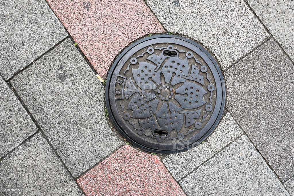 Manhole cover in Tokyo, Japan. stock photo