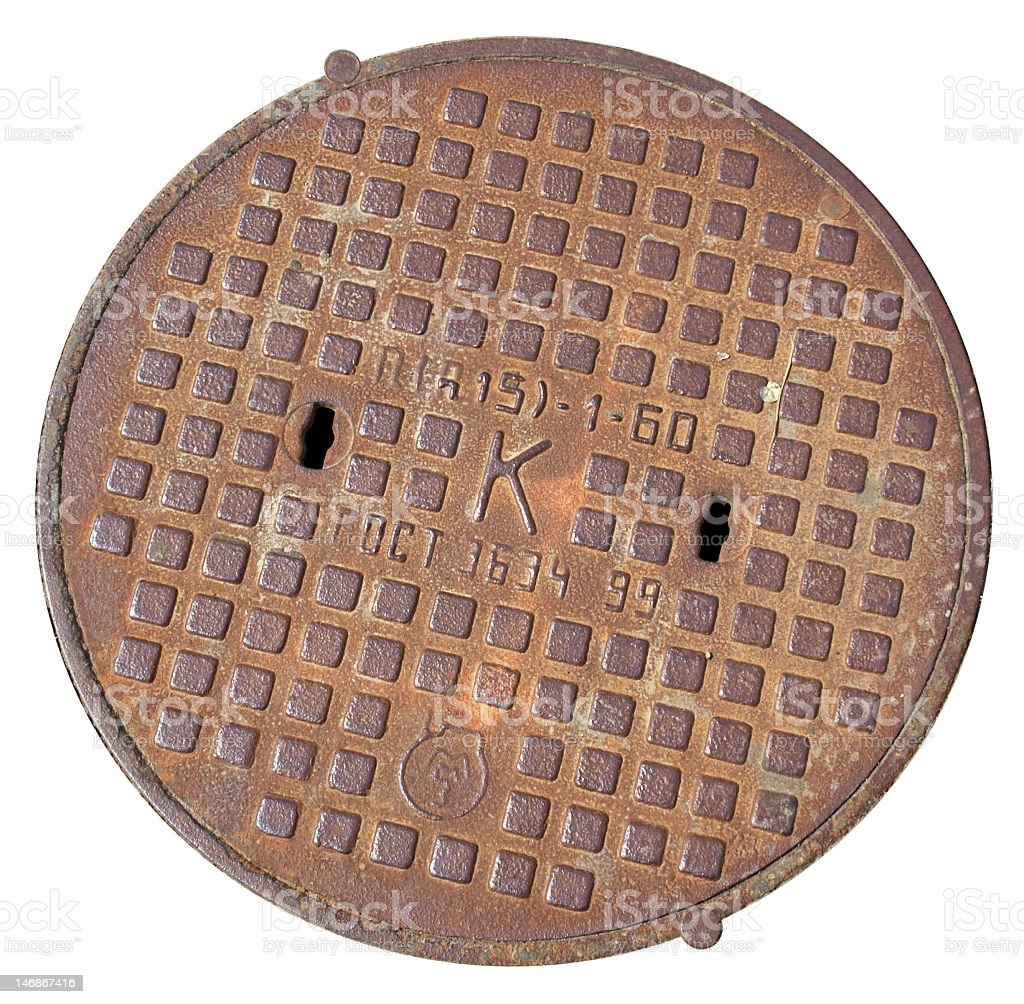 A manhole cover on a white background stock photo