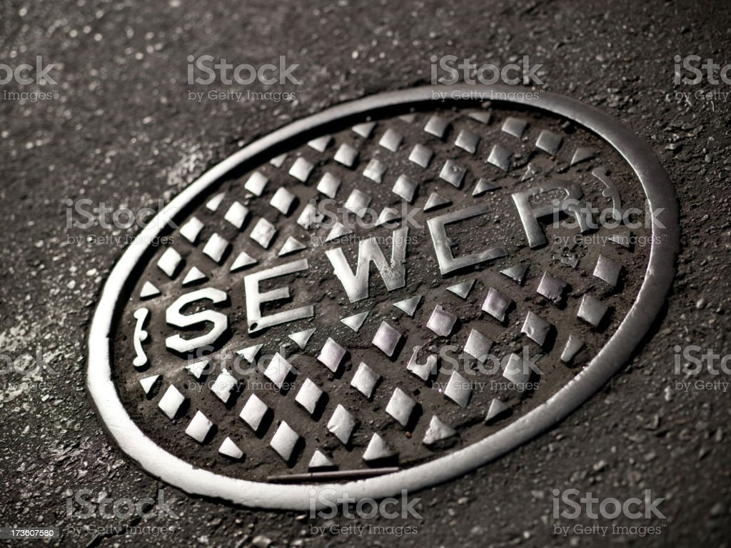Manhole cover on the road stock photo
