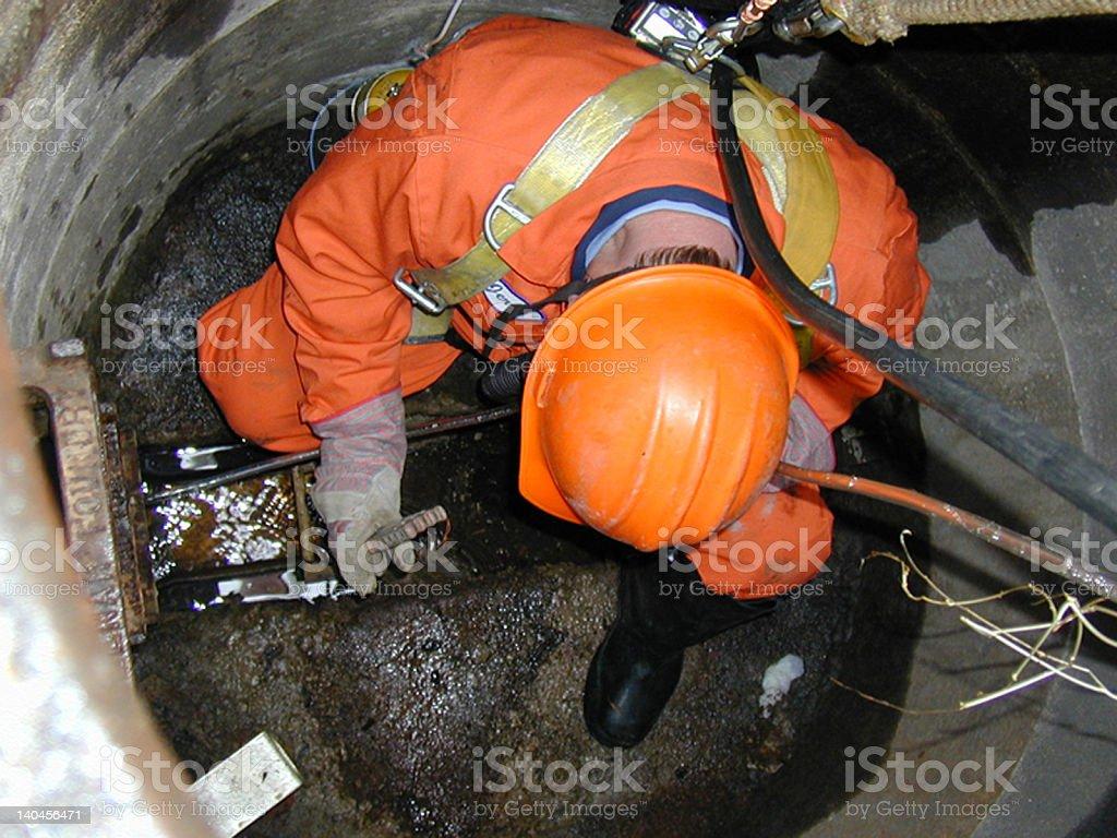 Manhole Man stock photo