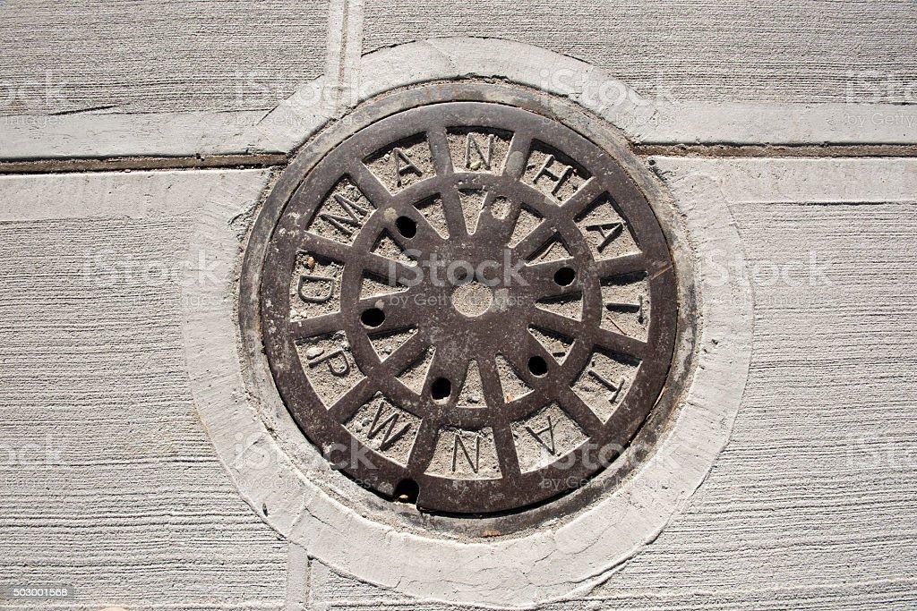 Manhole of the Manhattan sewage system stock photo