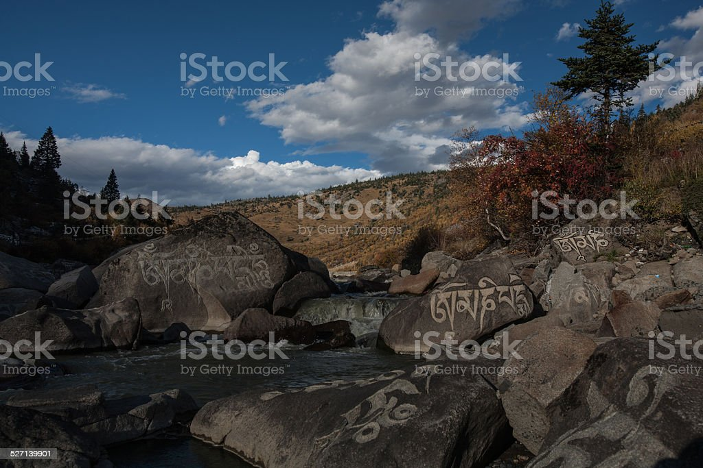 Mani stone, scripts of Tibetan Buddhism carved on rocks stock photo