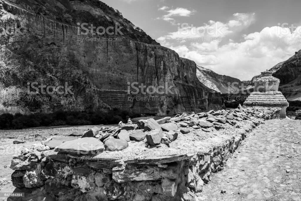 Mani stone wall and chorten in Markha valley stock photo