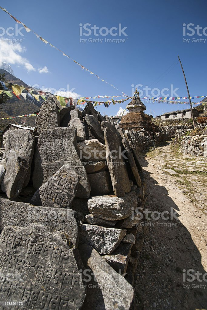 Mani stones and Buddhist stupe or chorten in Himalayas royalty-free stock photo