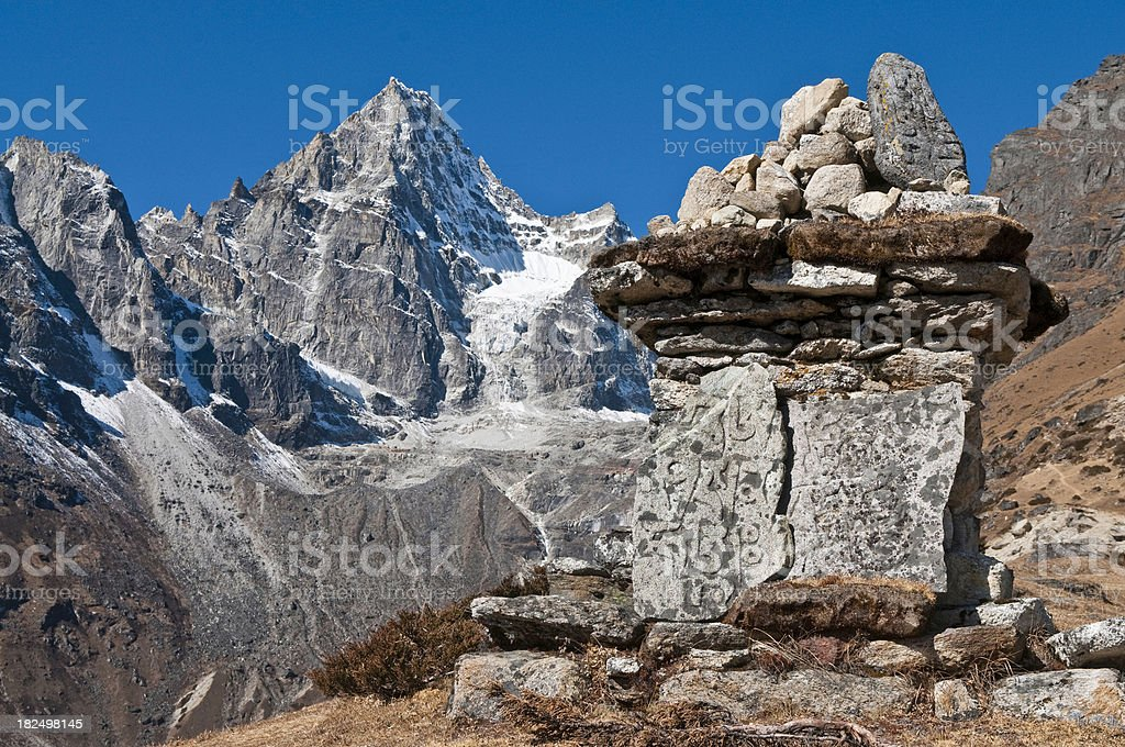 Mani Stones shrine high amongst remote Himalaya mountain peaks Nepal stock photo