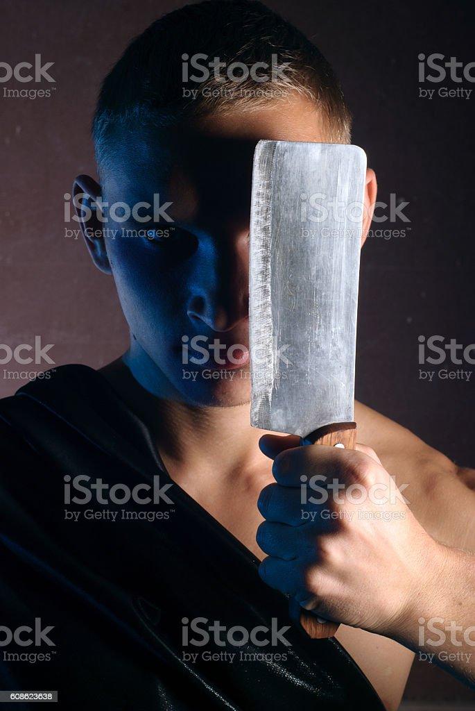 maniac with a butcher knife stock photo