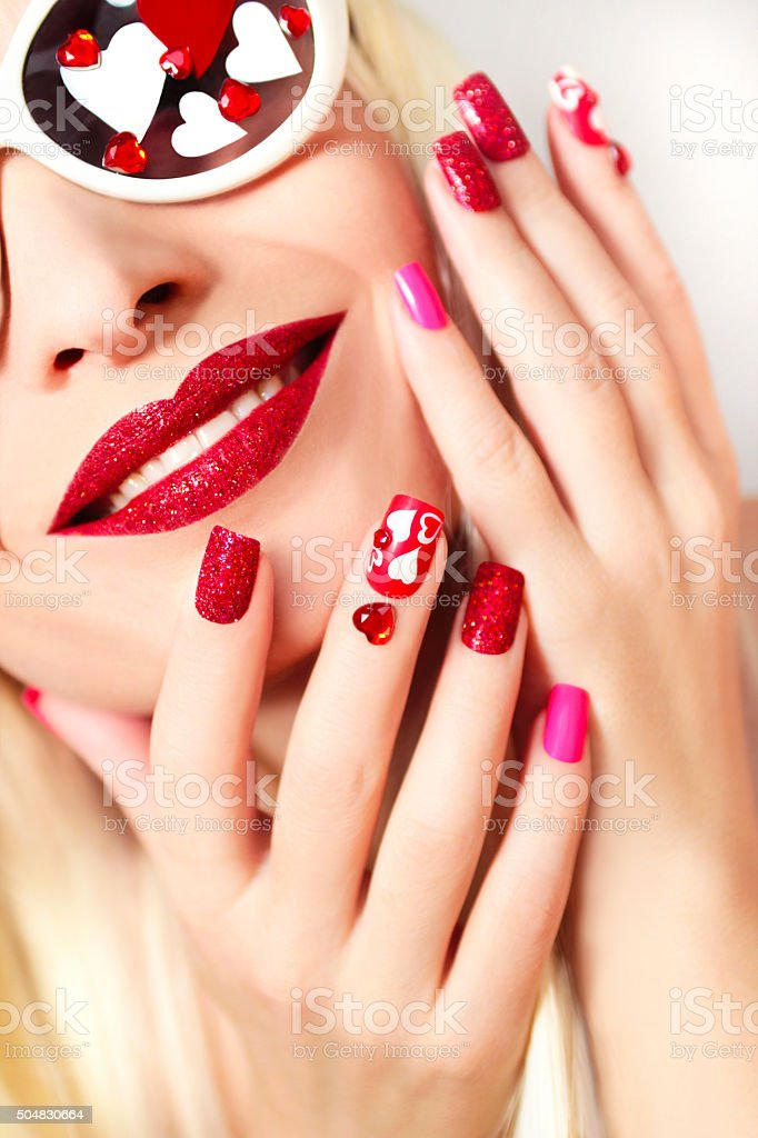 Manicure and makeup with hearts. stock photo