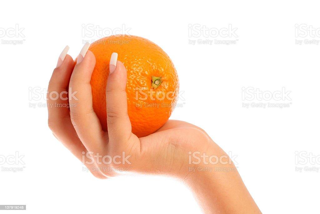 Manicure and orange royalty-free stock photo