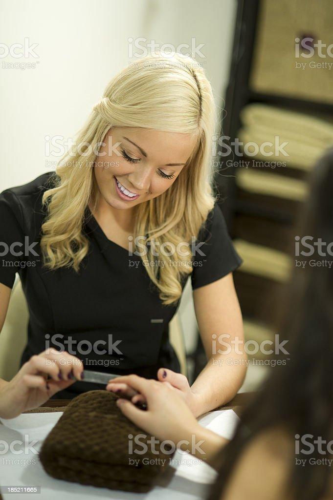 manicure at nail salon stock photo