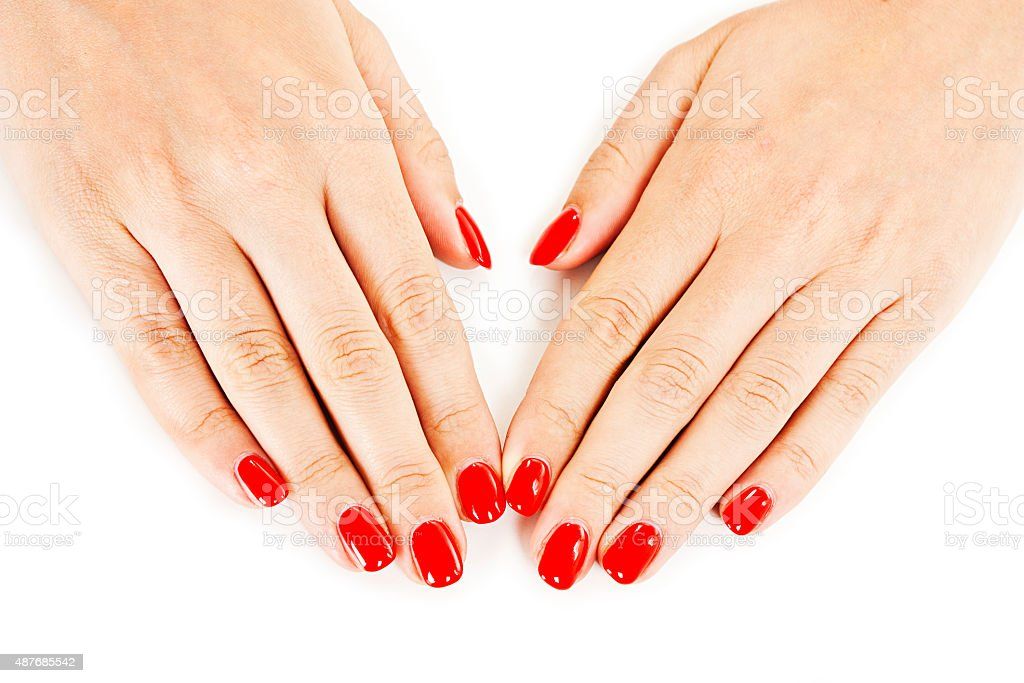 Manicure - Beautiful manicured woman's hands with red nail polish stock photo