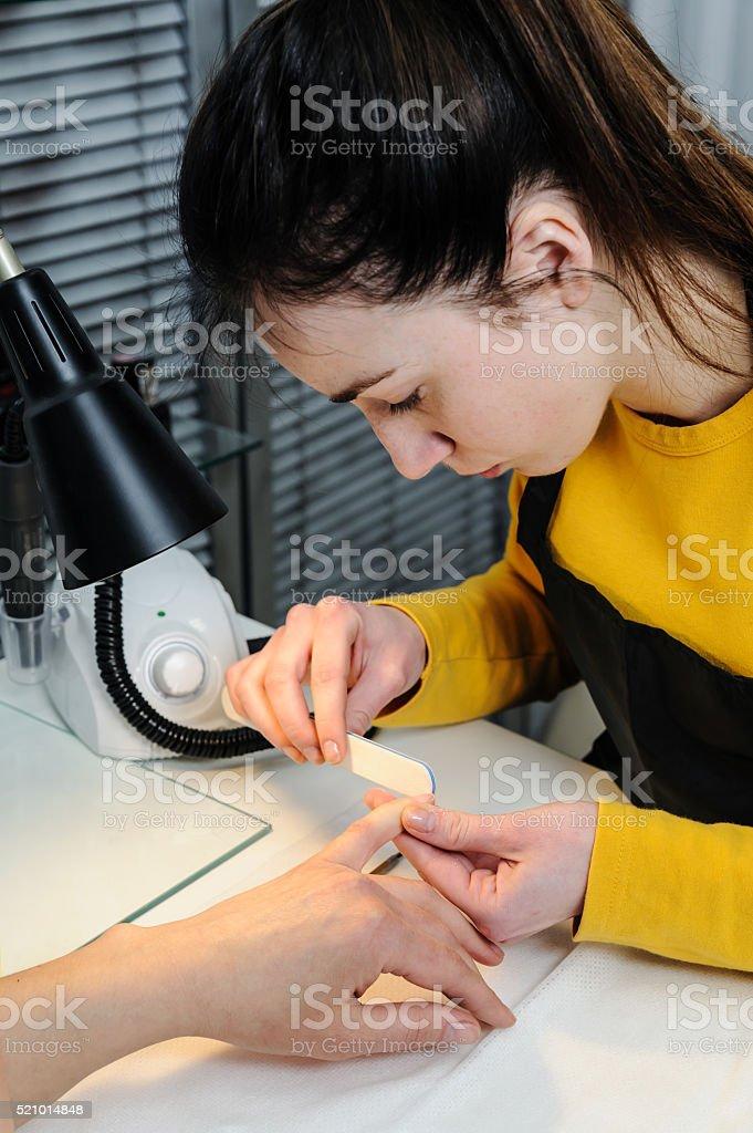 Manicure in a beauty salon. stock photo
