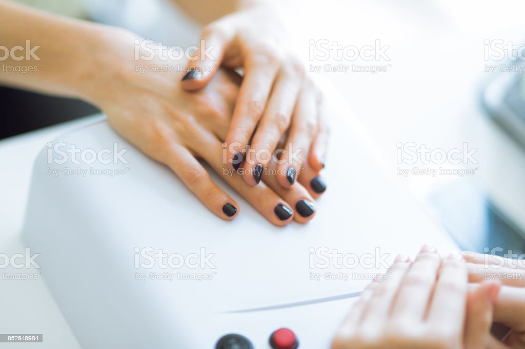 Manicure master and client stock photo