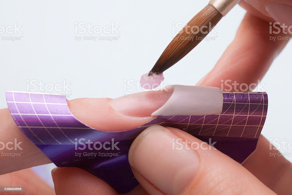 Manicure. Master make nail extension. stock photo