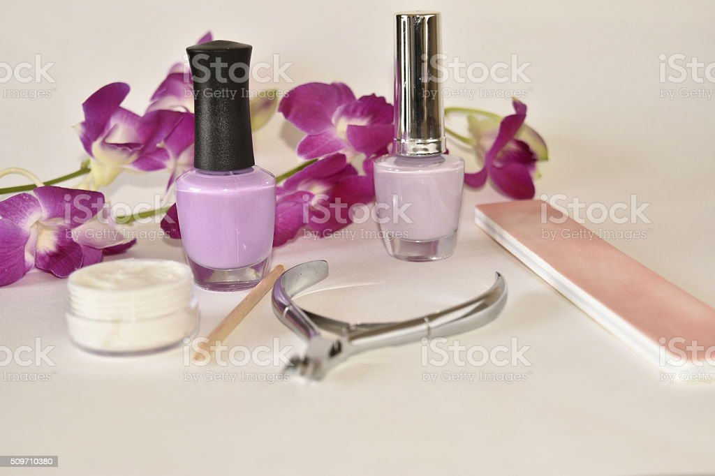 Manicure or pedicure set on white with Orchid stock photo