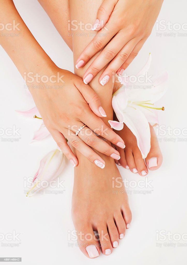 manicure pedicure with flower lily close up isolated on white stock photo