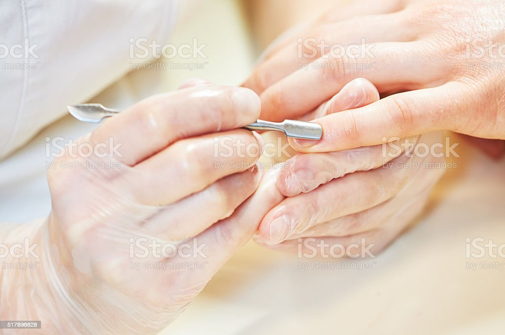 manicure specialist woman doing mail finger nail care stock photo
