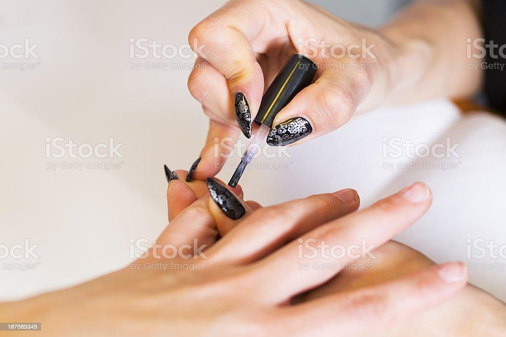 Manicure treatment...woman doing nail art royalty-free stock photo